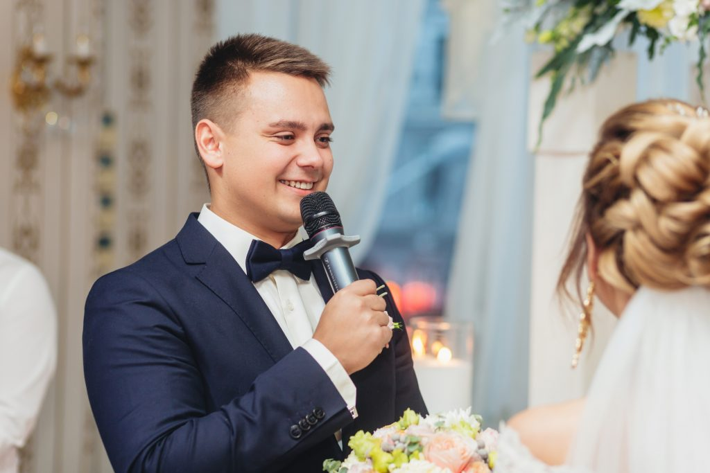 groom holding microphone and talking speech